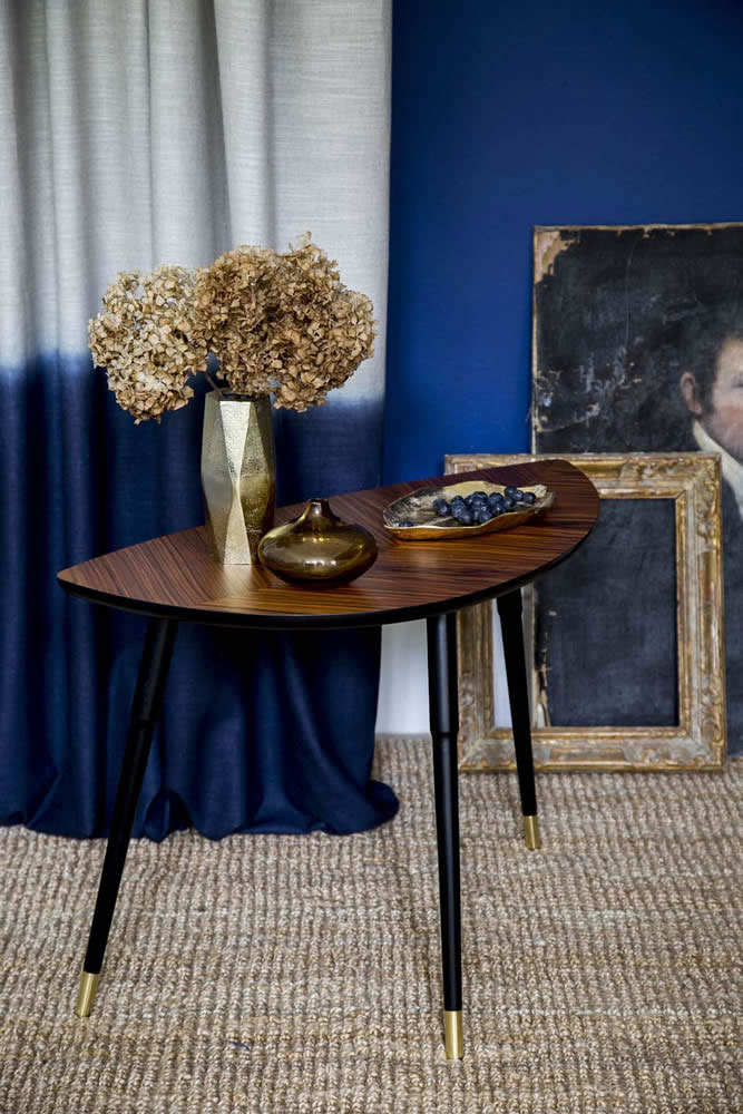 Contrast inky blue shades with twinkling copper accents